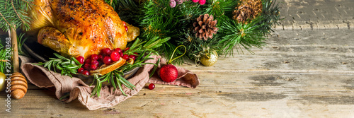 Fototapeta Traditional Christmas and Thanksgiving roasted whole chicken with fruit and rosemary. White marble table top view copy space obraz