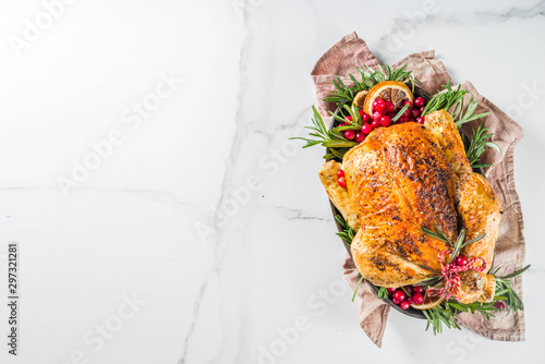 Traditional Christmas and Thanksgiving roasted whole chicken with fruit and rosemary Canvas Print