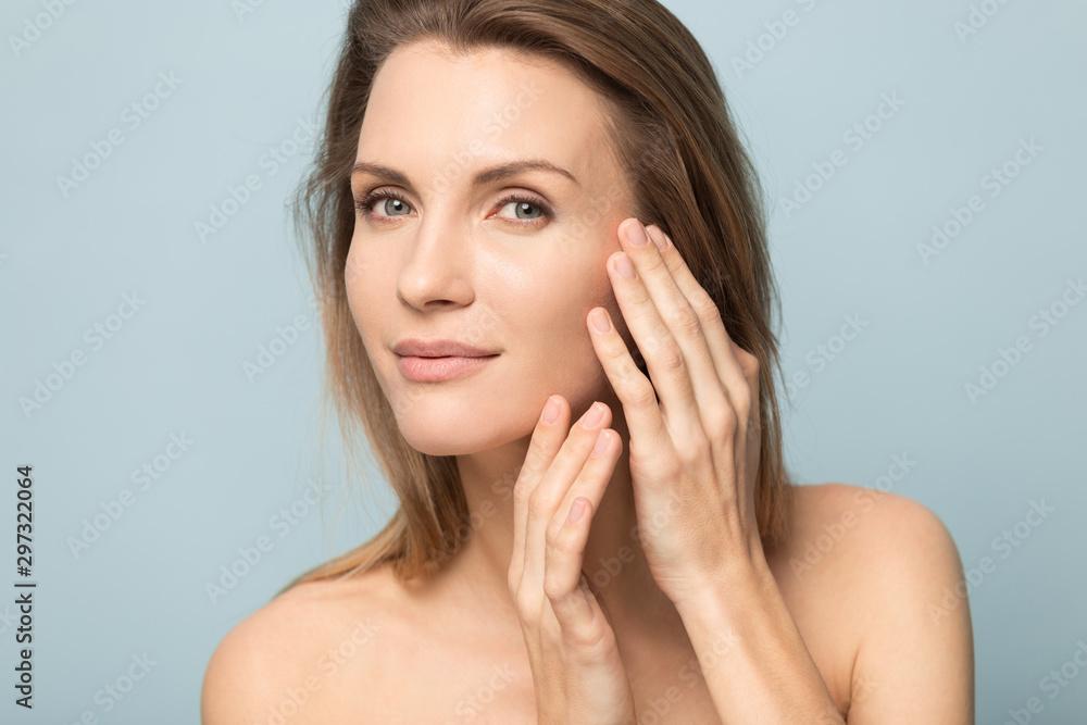 Fototapeta Millennial Caucasian woman touch soft healthy skin