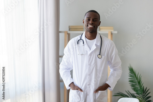 Portrait of biracial male doctor in uniform at hospital