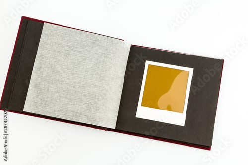 Vászonkép  album in front of white background, symbolic photo for memories and documentatio