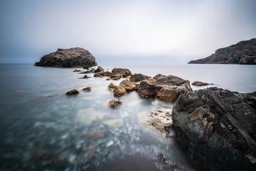 Big rocks in the sea at  Prevelli Beach, Crete, Greece, long exposure