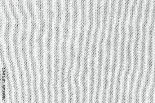 Tuinposter Macrofotografie White natural texture of knitted wool textile material background. White cotton fabric woven canvas texture