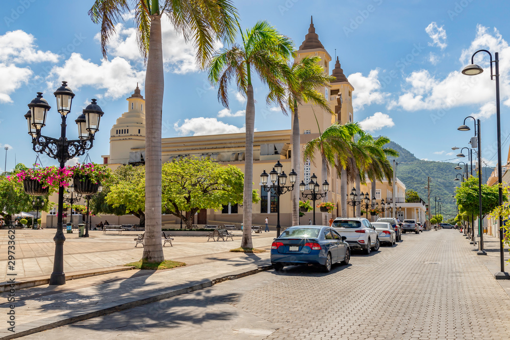 Caribbean old city street, church, independence square, tropical plants , palm tree, mountain view, Puerto Plata, Dominican Republic