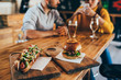 canvas print picture - couple having fun eating in food corner bar