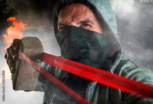 Obraz na plátně  young man as ultra and radical anarchist rioter