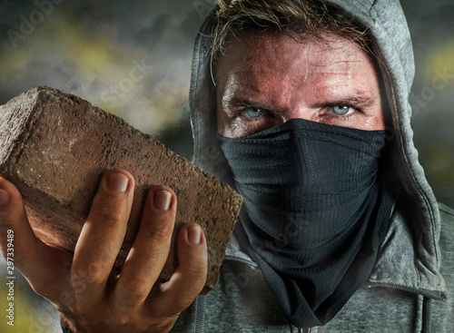 Photo young man as ultra and radical anarchist rioter