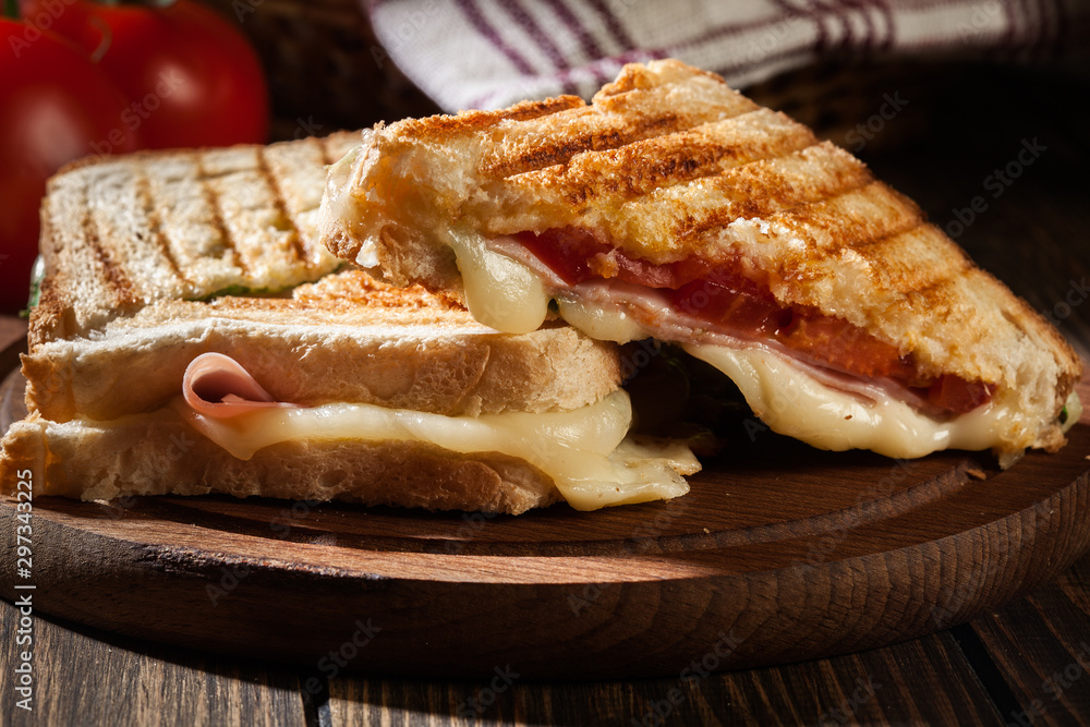 Fototapety, obrazy: Panini with ham, cheese and lettuce sandwich