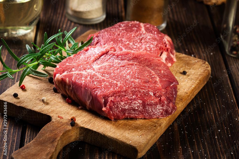 Fototapeta Fresh raw beef steak sirloin with rosemary