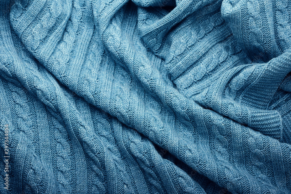 Fototapety, obrazy: Folds of a knitted woolen blanket, top view