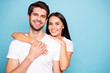 canvas print picture - Close-up portrait of his he her she nice-looking attractive charming lovely cute sweet cheerful cheery couple hugging isolated over bright vivid shine vibrant blue green turquoise background