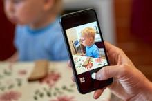 Hand Holds Smartphone Photogra...