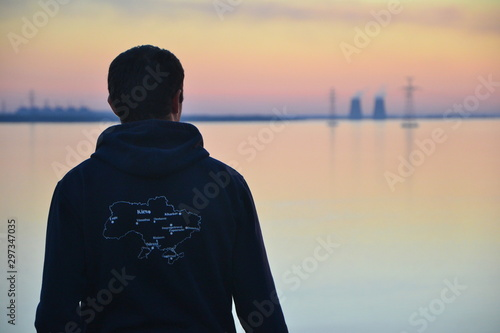silhouette of a man with map of Ukraine at sunset Wallpaper Mural