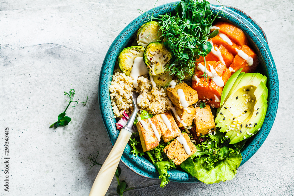 Fototapety, obrazy: Buddha bowl with quinoa, tofu, avocado, sweet potato, brussels sprouts and tahini dressing, top view. Healthy vegan food concept.