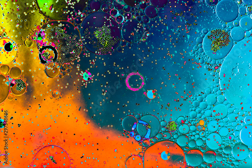 Macro shot of water oil emulsion over colored background - 297348646