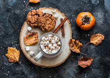 Hot Chocolate With Marshmallow, Cinnamon And Chocolate Chips Oatmeal Cookies On A Dark Background, Top View. Delicious Warming Autumn Drink
