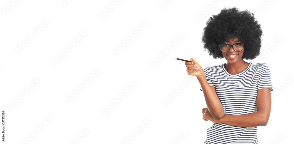Fototapety, obrazy: Happy afro woman with a pen isolated on white background.