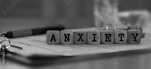 Photo Word ANXIETY composed of wooden dices.