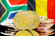 canvas print picture - Bitcoins on South Africa and Belgium flag background