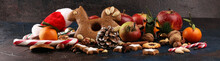 Christmas Cookies And Santa Had With Spieses, Nuts And Fruits On Rustic Table