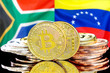 canvas print picture - Bitcoins on South Africa and Venezuela flag background