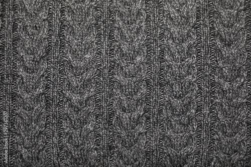 Grey melange cable knitting fabric textured background