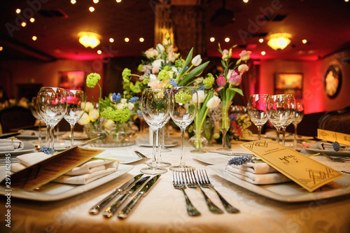 catering at a top event, glasses and flowers on the table, preparation for a sig Fototapeta