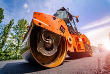 Road Repair, Compactor Lays Asphalt. Heavy Special Machines. Asphalt Paver In Operation. Side View. Closeup.