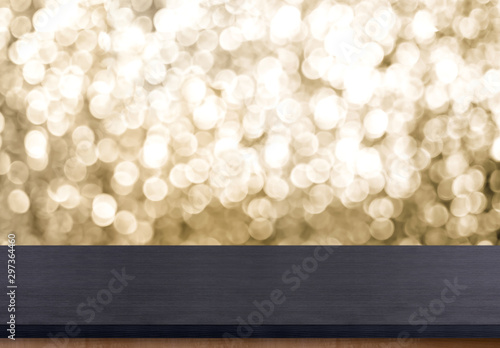 Fotografie, Obraz  Empty old rustic black wood table top with blur sparkling gold bokeh background,panoramic banner for display or montage of product,Holiday seasonal concept backdrop