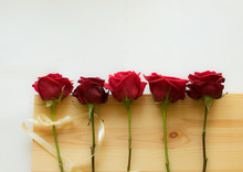 Five Dark Red Roses On A Woode...