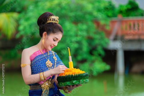 Portrait of beautiful asian woman in Thai dress traditional praying hold kratong Canvas Print