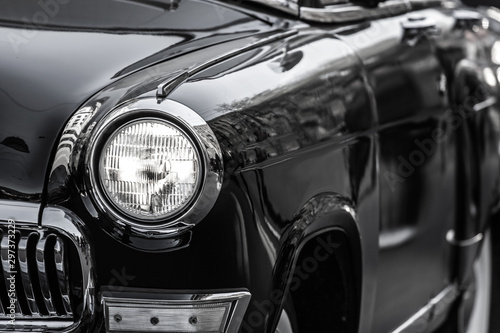 Poster Vintage voitures front part with the headlight retro car