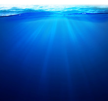 Undersea Background Light Rays Under Deep Water With Wave Surface Above