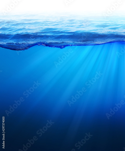 Photo  Under Water Sea background Light rays under deep water with wave surface above