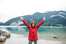A Senior Woman Hiker Standing By Lake In Nature, Stretching Arms.