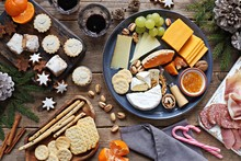 Festive Winter Appetizers Table With Various Of Cheese, Curred Meat, Sweets, Nuts And Fruits. Festive Family Or Party Snack Concept. Overhead View.