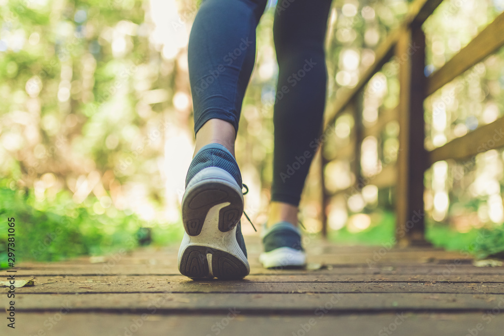 Fototapety, obrazy: Woman runner feet walking in nature. Close up on shoes. Healthy lifestyle fitness concept.