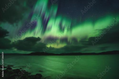 Photo Stands Northern lights Northern Lights, Aurora Borealis in Kola Peninsula at night sky illuminated green. Murmansk region, Russia