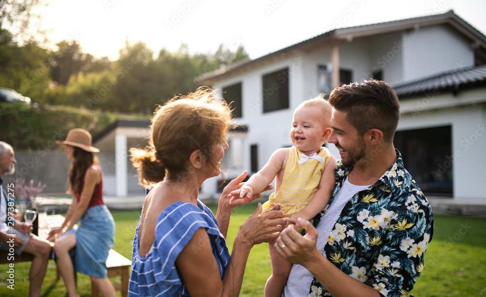 Fototapety, obrazy: Portrait of multigeneration family outdoors on garden barbecue.