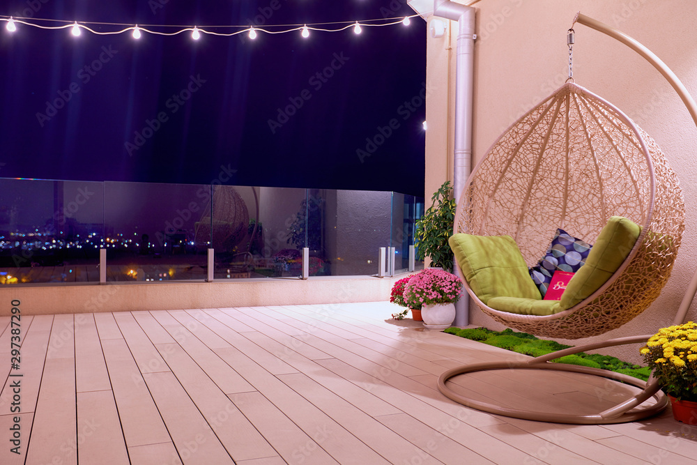 Fototapety, obrazy: rooftop patio area with hanging swing chair and string lights at night