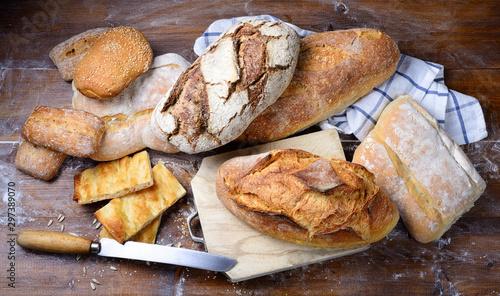 Obraz na plátně Assorted bread on wood background. Top view