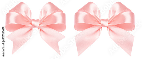 Fotografía Gift bow made of pink silk ribbon isolated on white background