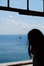 Girl Looking At Sea Through Wi...