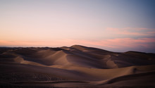 View Of Sand Dunes At Dusk