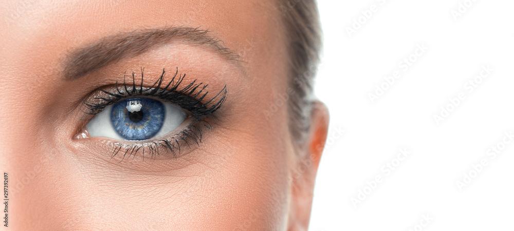 Fototapeta Close up photo of a woman's blue eye