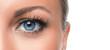 Leinwandbild Motiv Close up photo of a woman's blue eye