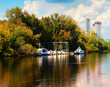 canvas print picture - Motor boats at quay during autumn season background