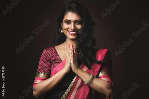 Fototapeta Beautiful Indian woman wearing traditional sari dress