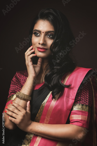 Fotografie, Obraz Beautiful Indian woman wearing traditional sari dress