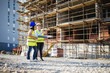 A two women construction workers on building site.Stock photo